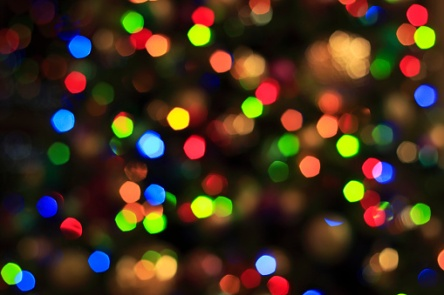 Colorful holiday lights background, defocused
