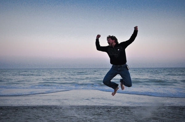 man-jumps-for-joy