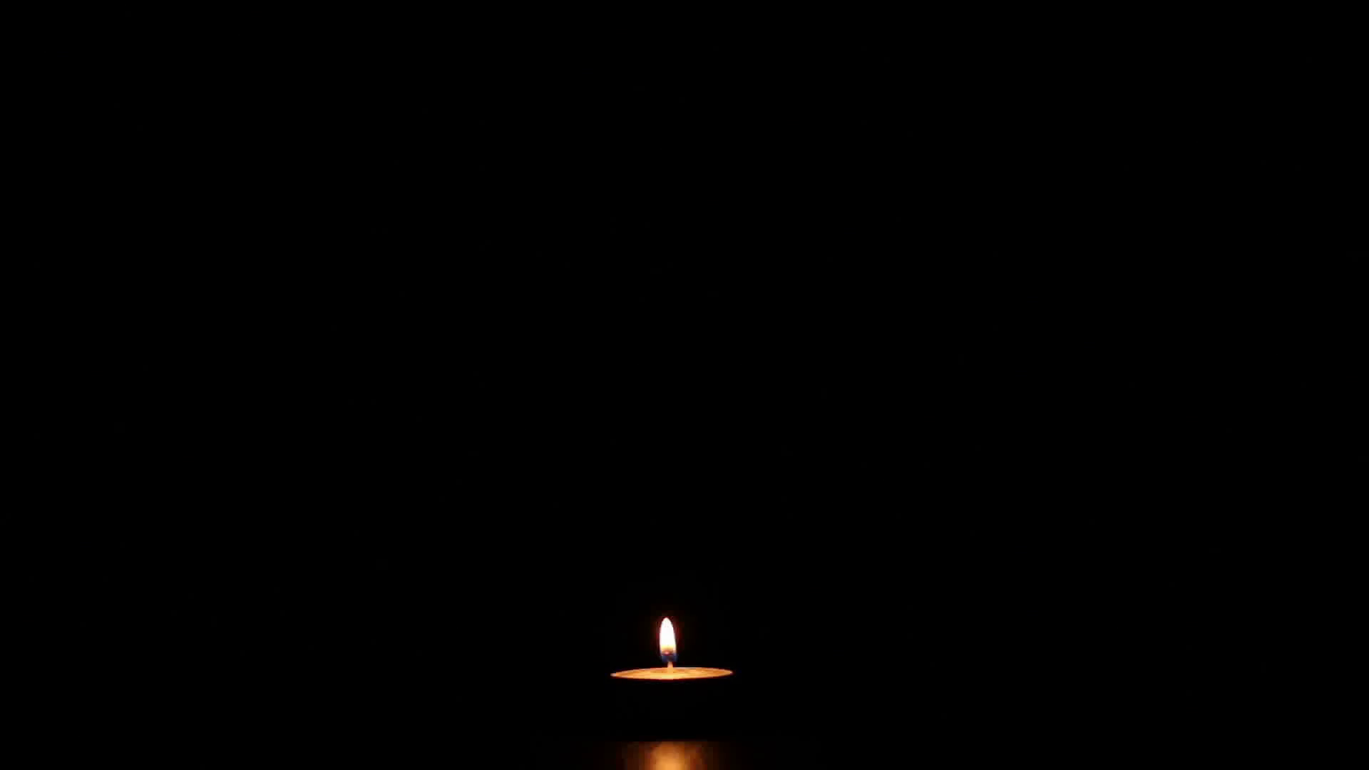 blowing-out-the-single-burning-candle-in-the-dark_sapstaaq_thumbnail-full01